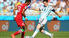 Lionel Messi of Argentina and Mehrdad Pooladi of Iran compete for the ball