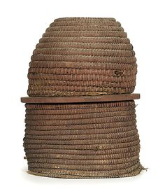~ American, ca 1900, a bee skep   of rye straw, flat-top and dome-top form, old red paint; ht. 24 in. ~