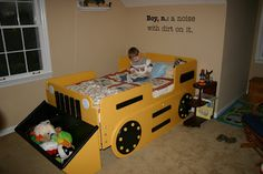My dad made this tractor bed for Hayden when he was 2 1/2 and he STILL loves it! I love that the bucket on the front is a great place for all of his stuffed animals. Shouldn't all boys have a tractor bed?!?!