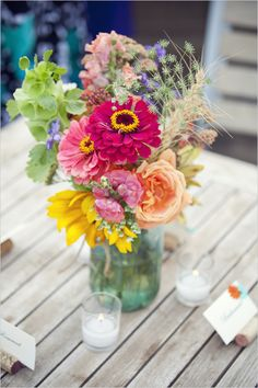 Beautiful bold colored mason jar flower arrangement. Flowers from half moon blooms Colbert WA