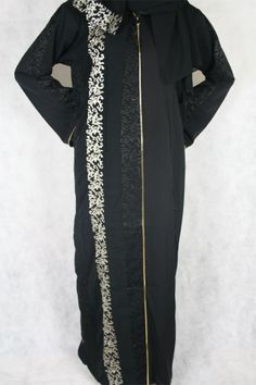 This Abaya is an open abaya with a flowery design running down one side and on arms with a zip front for the option to leave open. Comes with matching hijab.