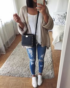 #fall #outfits white tank top beige loose sweater ripped jeans sneakers small black bag