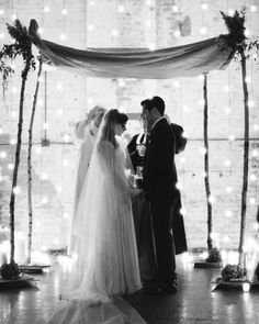 Lauren and Jason became husband and wife before a backdrop of string lights and under a sparingly embellished chuppah.