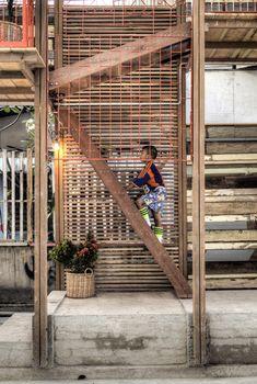 recycled wood panels, orange metal frames, open spaces