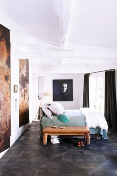 stunning parquet floors, eye-catching art and clean lines make for a luxe bedroom.