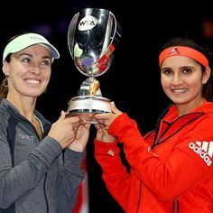 Sania Mirza & Martina Hingis crowned 2015 #WTAFinals doubles champions! Their 9th title of the year!   #SanTina