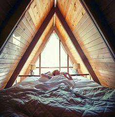 The best part of an A-frame is waking up in a dimly lit loft. This very good morning on the West Coast is brought to us by A Frame Cabin, A Frame House, Tiny House Cabin, Cabin Homes, Triangle House, Weekend House, Cabin Kits, Tiny House Movement, Cabins And Cottages