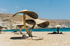 Surfing in Greece - Kolimbithra Beach, Tinos Greek Islands Off-the-beaten-path Summer Travel Beach Umbrella, Greek Islands, Summer Travel, Paths, Greece, Beautiful Places, Surfing, To Go, Journey