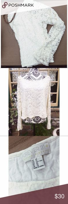 Lacey Long Sleeve Crop Top🌸 NWOT. Adorable lace crop top with floral detailing. Nothing wrong with it, I just never had any thing to wear with it. 😊 Forever 21 Tops Crop Tops