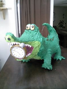 Full body crocodile with clock in his mouth. Approx 3ft & can hold 8lbs of goodies (candy not included). All pinatas are made to order & can