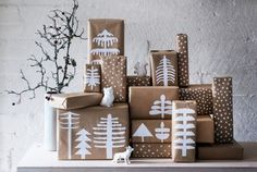 Cut simple wintery shapes out of plain white paper and adhere to kraft paper-wrapped packages. As seen in Deko of Finland, your charming gift pile can double as decor!