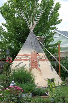if i ever have a house with a huge yard i am so building a tee pee!