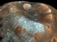 The large impact crater known as Stickney is the largest crater on the Martian moon Phobos. Credit: NASA/JPL-Caltech/University of Arizona Cosmos, Carl Sagan, Mars Moons, Earth Gravity, Planets And Moons, Astronomy Pictures, Nasa Images, Nasa Photos, Mission To Mars