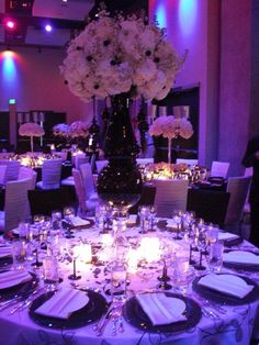 purple lighting, black accents on center pieces and candle lights