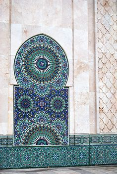 The Hassan II Mosque is in Casablanca and is the largest mosque in Morocco and the fifth largest in the world. Designed by French architect Michel Pinseau, it stands on the edge of the coast looking out to the Atlantic; the water can be seen through a giant glass floor with space for 25,000 worshippers. A further 80,000 can be accommodated in the mosque's adjoining grounds for a total of 105,000 worshippers present at any given time at the Hassan II mosque. Its minaret is the world's…