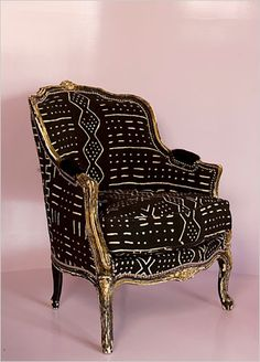 Fabulous Furnishings. A Louis IX style chair, bought at a Paris flea market, was upholstered in African mud cloth — an unlikely choice of fabric, but one that makes this chair fit into a modern interior. Interior Design: BKH Design.