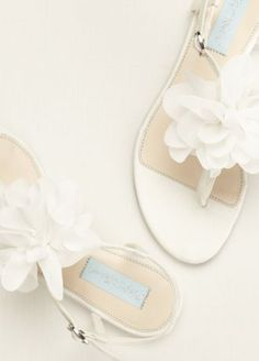 This satin thong sandal with delicate chiffon flower accent is a must have no matter what season!  Blue by Betsey Johnson satin thong sandal features beautiful chiffon flower accent.  Available in Ivory,  Fully lined. Imported.