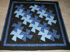 Large twister quilt in blues & black, throw size.