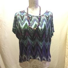 Multicolor top Multicolored Hilow top loosefitting gently used Tops Blouses