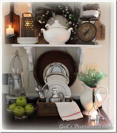 Shelf vignette...love the old grater and scale