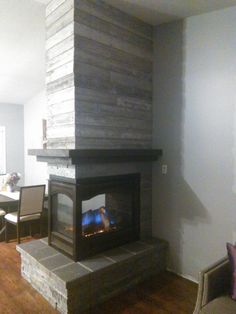 3 sided fireplace with barnboard