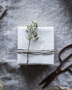 Wabi sabi gift wrapping. Find more inspiration for your gifts this year —think Japanese paper, naturally dyed silk ribbon, printed papers, muslin, twine, and nature bits—on the blog! Link in profile. Plus we're giving away a laptop...find details in the previous Instagram post or on the blog! There's a fire crackling in our hearth with a babe asleep in front of it in her bassinet. A lot of work was done on the house today (@workstead fixtures installed & @kalonstudios bed put together! Pics…