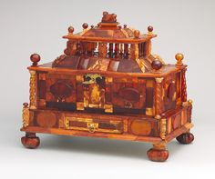 """Casket, ca. 1680 Michel Redlin (German, documented 1688) Poland (Gdansk) Amber, gold foil, gilded brass, wood; 11 7/8 x 13 x 8 1/4 in. (30.5 x 33 x 21 cm) Following ancient traditions, in the Renaissance and Baroque periods amber, """"the gold of the Baltic sea,"""" was regarded as a substance of mythical origin and magical power. This parade casket is one of the most important and best preserved examples of amber work to have survived from the seventeenth century."""