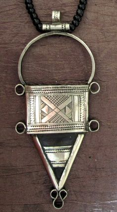 Tuareg Silver Necklace, Ebony Inlay and onyx beads, ' INGALL' €89    Typical geometric patterns used by the Tuareg Silversmith' s with Tifinagh inscription at the back.     Measures:     Total Lenght: 44 cm     Ingall pendant: 10 x 4.3 cm    www.Tuareg-Jewelry.com  https://www.facebook.com/TuaregJewelry