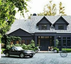 I've had this picture saved for ages and came across it again today. Greenery (and a killer car) always look so beautiful against a dark exterior. : likes Natural Wood Cabinets: Why We Can't Get Enough Black House Exterior, Cottage Exterior, Modern Farmhouse Exterior, Exterior House Colors, Exterior Design, Exterior Stairs, Dark Grey Houses, Dark House, Studio Mcgee