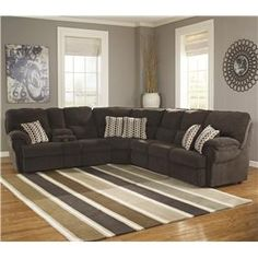 Thick pillow top cushioning over flared arms add comfort with unique style to this sectional. The power reclining loveseat section features two reclining seats and a center storage console. It also includes two reading lights dual USB charging ports and two cup holders. The reclining seats are operated via buttons on the console to keep a sleek look on the arms of the sectional. The sleeper sofa section offers a queen-size memory foam pullout mattress for guests to comfortably stay overnight…