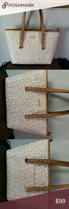Calvin Klein light beige shoulder bag purse Great pre-loved condition. Nice and clean. The only issues with it are three pink dots on the back corner. Carried only a handful of times. Got many many compliments. Calvin Klein Bags Shoulder Bags