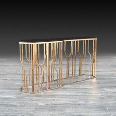 a9ae9b81f6e8bf Lorensia Large Rose Gold Console Table features a silver polished stainless steel  base with two different