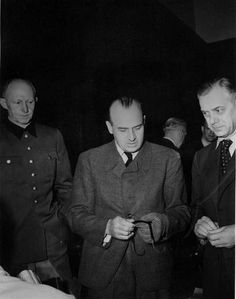 General Alfred Jodl, Hans Frank, and Alfred Rosenberg at the Nuremberg Trials, Germany, 1946; Photographer: Charles Alexander; Source: Harry S. Truman Library and Museum; ID: 72-918