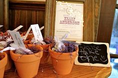 shower favors - pots with flower seeds that are supposed to bloom around the wedding day. Would be fun for baby shower too.