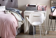 Umbra Oh Chair makes a great desk chair. Curved lines add comfort. Stackable for easy storage. See more dorm room decor inspiration.