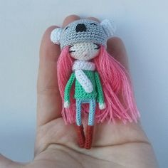 Tiny amigurumi doll wearing a koala bear hat. (Inspiration).
