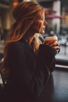 Messy hair chunky sweater and coffee