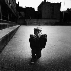 Photo Exhbit - Arthur Tress: Dreams, Visions and Voyages - Silver print by Arthur Tress - Child with Hockey Gloves, Hell's Kitchen, New York Arthur Tress, Scary Photos, Hockey Gloves, Photo Repair, Art Grants, Vintage Words, Dream Images, New York Museums, Dreams And Nightmares