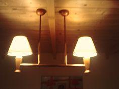 Lámpara confeccionada por javier vega regueiro, con tubería de cobre, ideal para salvar vigas.