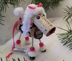 THE CUTEST WINE CHRISTMAS ORNAMENTS EVER. Start your pack today!  The Winedeer™ Chateauneuf Du Pup - White Poodle is handcrafted using assorted re-purposed happy wine cork. Some may have red wine stains and cork screw marks that add personality to the ornament. Nine different dog patterns available.  One of over 260 different styles and colors to choose from.  **PRICE REFLECTS --ONE-- ORNAMENT ONLY**  Picture represents color pattern,legs and tail colors. Product shipped will have different…