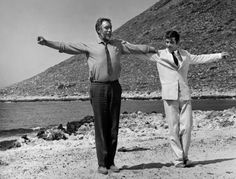 Anthony Quinn as Alexis Zorbas and Alan Bates dancing syrtaki in Zorba the Greek(1964)