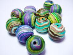 Free bead tutorial from Polynana's Place  http://polynanasplace.blogspot.com/2011/03/planet-bead-tutorial.html