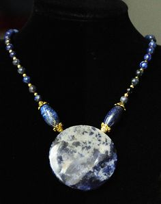 Sodalite pendant with Lapis Lazuli and golden Bali silver elements.