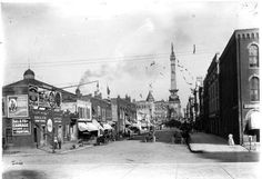 """Early 1900's, street leading to Monument Circle, Indianapolis. My father, at age 9 years, drove a horse & wagon full of vegetables, grains, & fruits to City Market for a local """"truck"""" farmer from Indy's southside."""