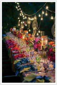 Love the strung lights, the candles and the multicolored napkins