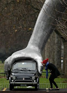 Lorenzo Quinn's 'Vroom Vroom' sculpture is installed in its new setting on Park Lane in London. The four-metre high sculpture consists of a vintage Fiat 500, the first car that the sculptor ever bought, grasped by an oversized aluminium child's hand modelled from Quinn's son. text & image via the Telegraph