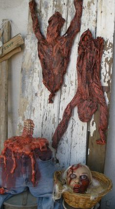 partial torture scene area for Halloween 2014. Skinned human pelts (Stiltbeast tut), bloody torso, severed head.