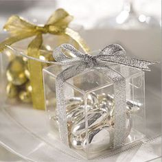 i think this is a really cute idea :)  CLEAR CUBE FAVOR BOXES