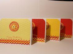 Die cut, heat embossed, dry embossed color coordinated Happy Birthday Cards.