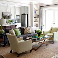 Define with Green  In an open floor plan, soft lime-green accents provide visual separation between the living room and kitchen. Neutral colors in the kitchen create a simple backdrop for the living room?s punchier palette, which consists of warm earth tones with a pop of lime green. Selecting just a few green pieces, such as an accent chair or lamp, allows you to change your palette with ease.